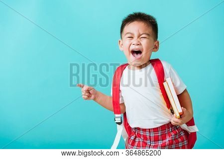 Back To School Concept. Portrait Asian Happy Funny Cute Little Child Boy Smile Hug Books And Point F