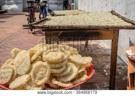 Sundried Sticky Rice Cakes On The Street In Luang Prabang