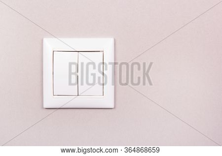 White Plastic Switch On Gray Background. White Two-button Switch. White Plastic Switch Copy Space