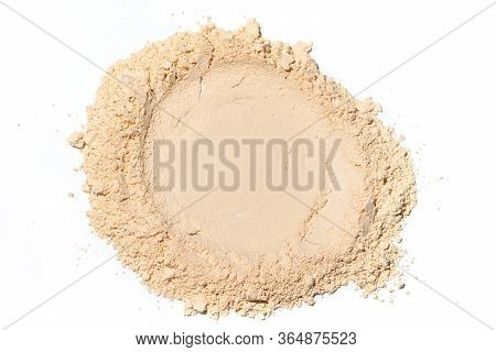 Whitening Mineral Loose Powder.scattered Tan Colored Facial Loose Powder On White Background.