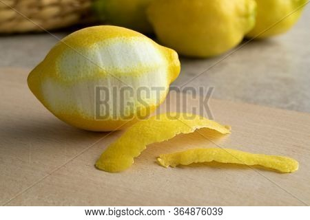Fresh lemon and thin peel in front close up