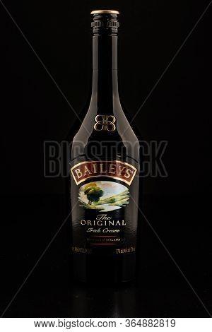 Varna, Bulgaria - April 20, 2020. Baileys Irish Cream Bottle, On Black Background. Baileys Irish Cre