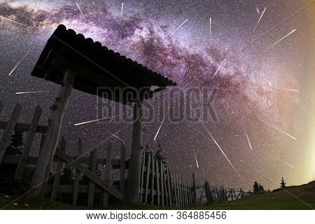A View Of A Meteor Shower And The Purple Milky Way With Wooden Entrance Door With A Roof And Fence S