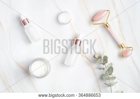 Set Of Natural Cosmetic For Face Treatment. Flat Lay, Top View Face Massage Roller, Serum In Dropper