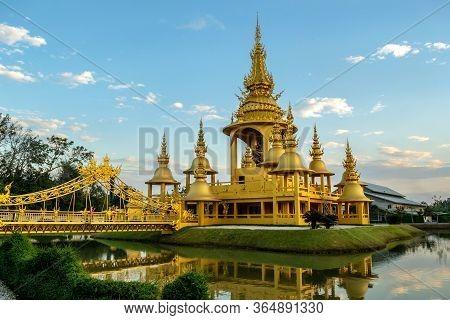 Chiang Rai, Thailand - December 10, 2019: Golden Temple Near Wat Rong Khun At Sunset