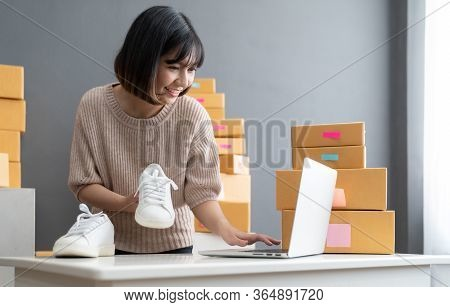 Startup Small Business Owner Working With Computer At Workplace. Freelance Woman Seller Check Produc