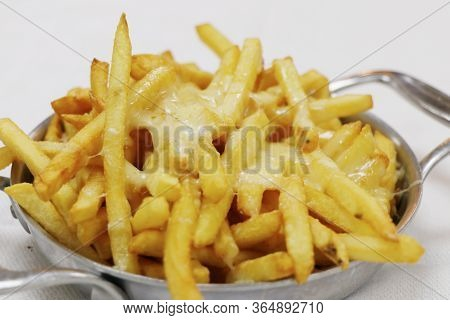 Melted Cheesy Fries In A Metal Bowl With White Background