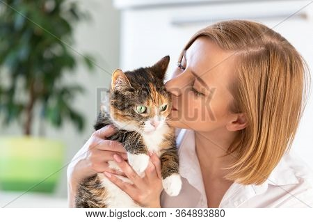 Close Up Of Smiling Woman In White Shirt Kissing And Hugging With Tenderness And Love Cat, Holding H