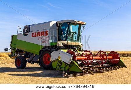 Turegano, Segovia / Spain - 09 October 2016: Combine Harvester On The Edge Of The Field.