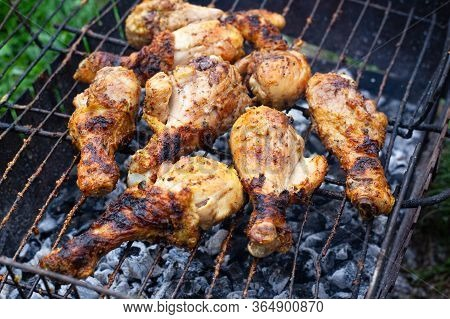 Toasted Chicken Drumstick With Crispy Crust On The Grill. B-b-q, Picnic, Delicious Dinner Cooked Out