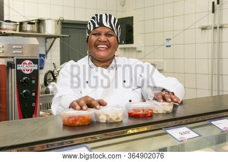 Johannesburg, South Africa - February 24, 2016: African Female Staff At Counter Of  Butchery And Del