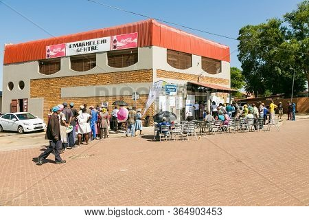 Customers Waiting In Line At Entrance To Local Pick N Pay Grocery Store