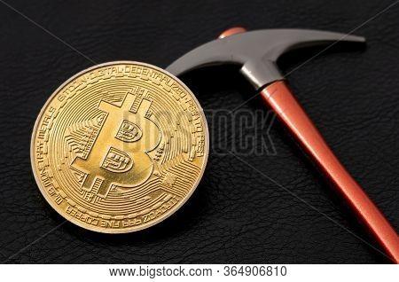 Bitcoin Lying On The Pickaxe, Btc Mining Concept