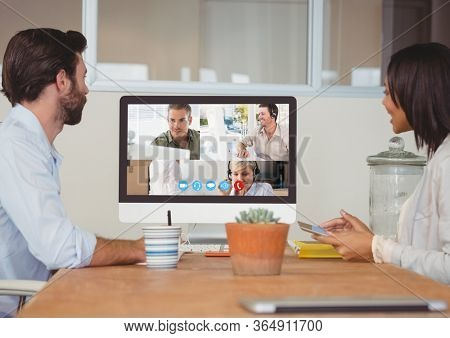 Couple during a video call with their friends and family on computer self isolating at home with coronavirus Covid 19 spreading. Public health social distancing and self isolation in quarantine
