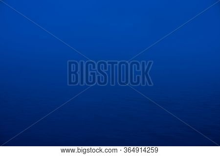 Natural Texture Of Deep Blue Calm Water In Dusk Close Up. Night Sea Of Blue Classic Color. Water Rip