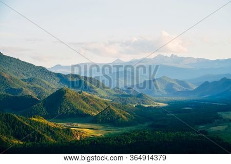 Wonderful Mountain Land With Forest And Small Houses In Sunlight. Scenic View To Vast Expanses Of Ro