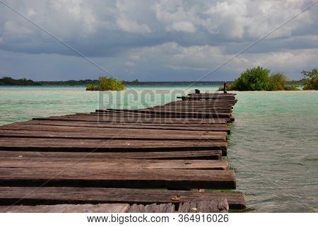 Wooden Pier On Bacalar Seven Colours Lake, Quintana Roo. Mexico, Yucatan.