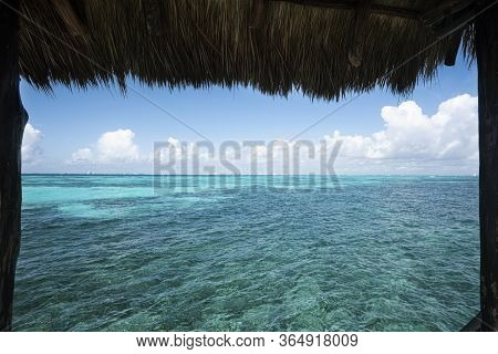 Thatched Roof Of A Water Hut Overlooking The Caribbean Sea In Isla Mujeres Mexico, Travel And Nature
