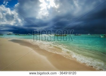 Storm And Rain Coming To The Caribbean Sea Of Playa Del Carmen Mexico. Fishing Boats Anchored Near T