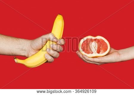 Erotic Banana And Donut In The Hands As A Symbol Of The Penis And Vagina Isolated On A Red Backgroun