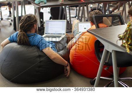 Belarus, Minsk City, August 06, 2017. Programmers Office. It People At Work. Programmers On Comforta