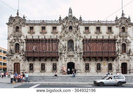Lima, Peru; February 25 2011: Main Facade Of The Palacio Arzobispal, Located In The Plaza De Armas