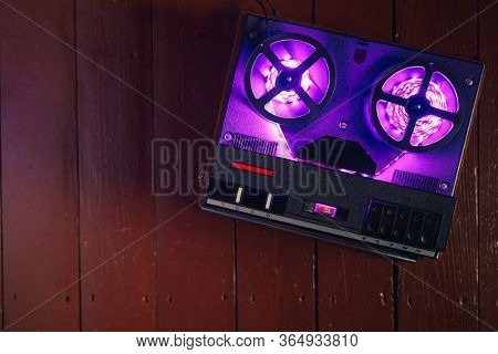 reel-to-reel audio tape recorder with purple led light strip
