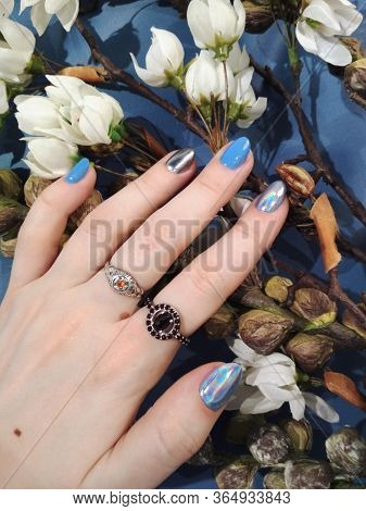 Woman Hand Finger Blue Silver Metallic Holographic Manicure Gel Nail Polish Swatch Design Beauty Pho