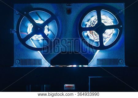 reel-to-reel audio tape recorder with blue led light strip