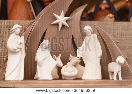 Christmas Nativity Scene Wooden Figurines Inside A Wooden House Representing The Holy Family
