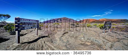 Panoramic view of Piton de la Fournaise volcano with sign in foreground, Reunion National Park, Reunion Island.