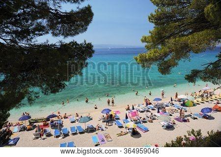 Baska Voda - Croatia - August 15 2019: Crowd Of People Od Baska Voda Beach In Summer Season