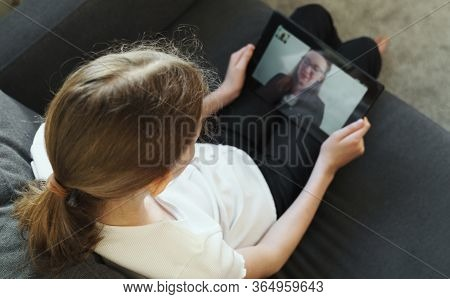 Little Girl Making Video Call With School Teacher Or Mother.
