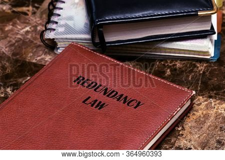 Redundancy Law About Termination And Employee Right. The Text Is Written On A Book Lying On A Marble