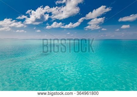 Tranquil Tropical Sea Ocean View, Seascape Background Under Skyscape. Amazing Turquoise Azure Sea Wa