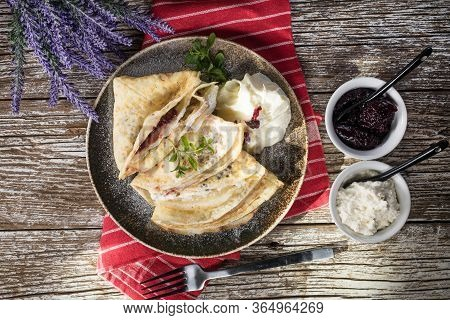 Crepes With Ricotta Cheese And Blackcurrant Jam. Delicious Crepes, Thin Pancakes. Top View.