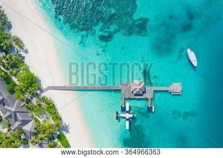 Perfect Aerial Landscape, Luxury Tropical Resort Or Hotel With Water Villas And Seaplane And Wooden