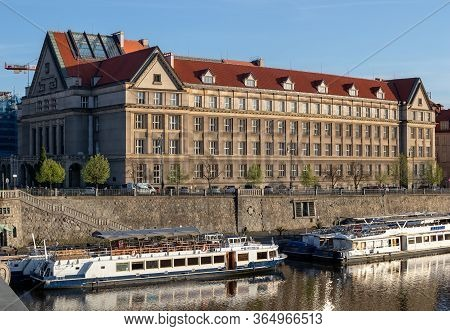 Prague, Czech Republic - April 16, 2020: Faculty Of Law, With Boats On The Vltava River In The Foreg