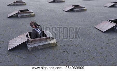 businessman in a gas mask peeps out of a refuge hatch, 3d illustration