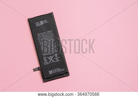 April 11, 2020, Rostov-on-don, Russia:  Lithium Ion Black Battery From Apple Iphone 6 On A Pink Back