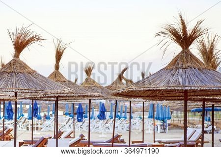 Empty Deck Chairs For Relaxing By The Sea. Sea Beach Many Empty Sunbeds For Leisure Travelers.empty