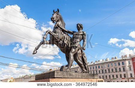 St. Petersburg, Russia - August 5, 2015: Sculpture Tamer Of Horses At The Anichkov Bridge, Designed
