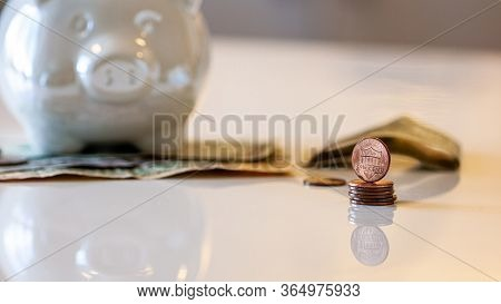 Personal Finances, Close-up Of A Piggy Bank With American Dollars - Wealth And Financial Concept