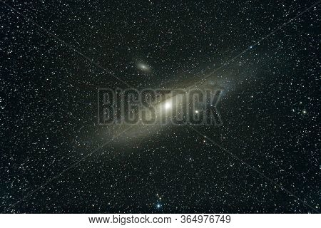 The Andromeda Galaxy , Also Known As Messier 31, And Originally The Andromeda Nebula Is A Barred Spi