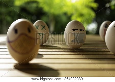 Funny Eggs With Human Faces. Eggs Wearing Face Masks Or Colored Chinstraps. Selective Focus. Chinstr