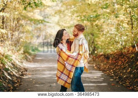 Beautiful Couple Man Woman In Love. Smiling Laughing Boyfriend And Girlfriend Wrapped In Yellow Blan