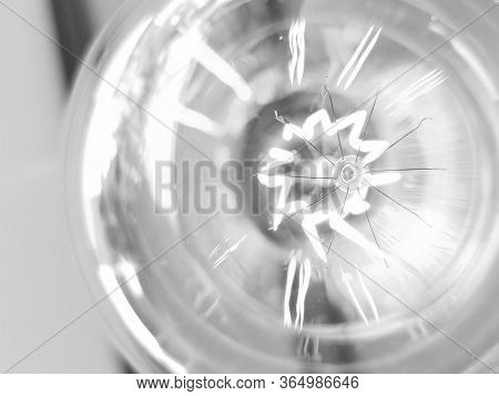 Amazing Spiral Electric Current Inside A Retro Crystal Clear Light Bulb.