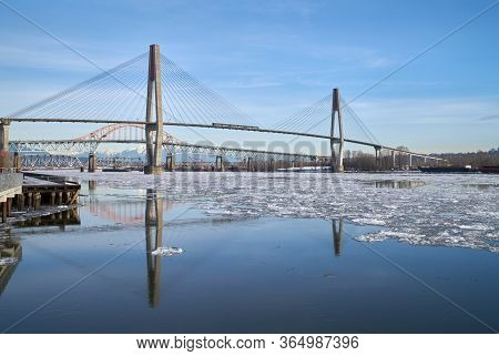 Fraser River Bridges And Winter Ice. Ice Flowing Down The Fraser River. New Westminster, British Col