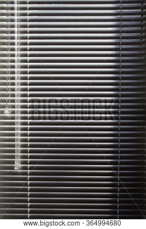 Horizontal Blinds. Sunlight Coming Through Venetian Blinds By The Window.