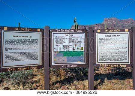 A Description Board For The Trails In Apache Trail, Arizona